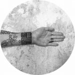 Custom pattern tattoo on the wrist