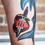 Dagger pierced heart tatto by david côté