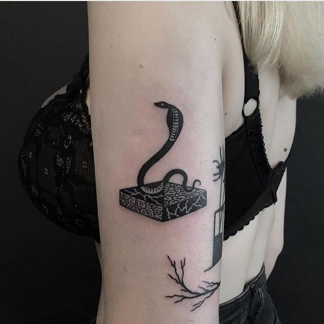 Dancing cobra tattoo