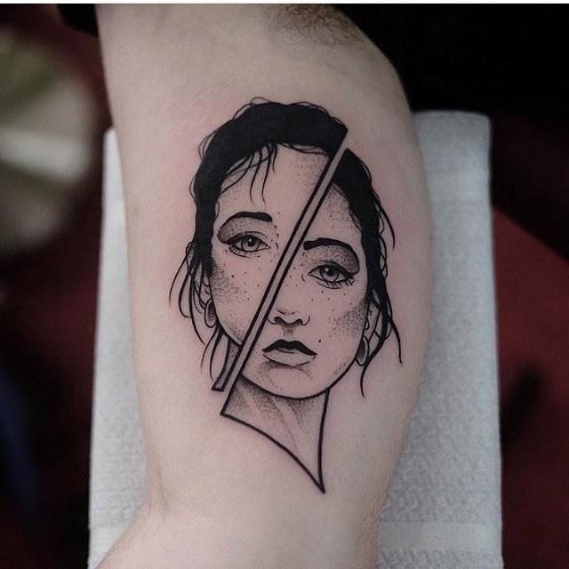 Divided face tattoo by jonas ribeiro