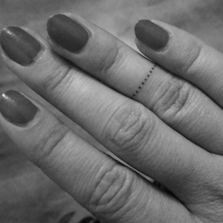 Dotted ring tattoo