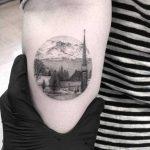 Fine line circular landscape tattoo
