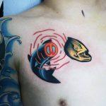 Fish and head tattoo