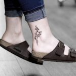 Floral piece on the ankle by stella