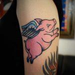 Flying pig tattoo