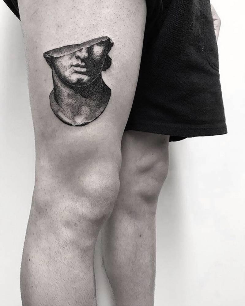 Fragmentary colossal head tattoo by koldo novella