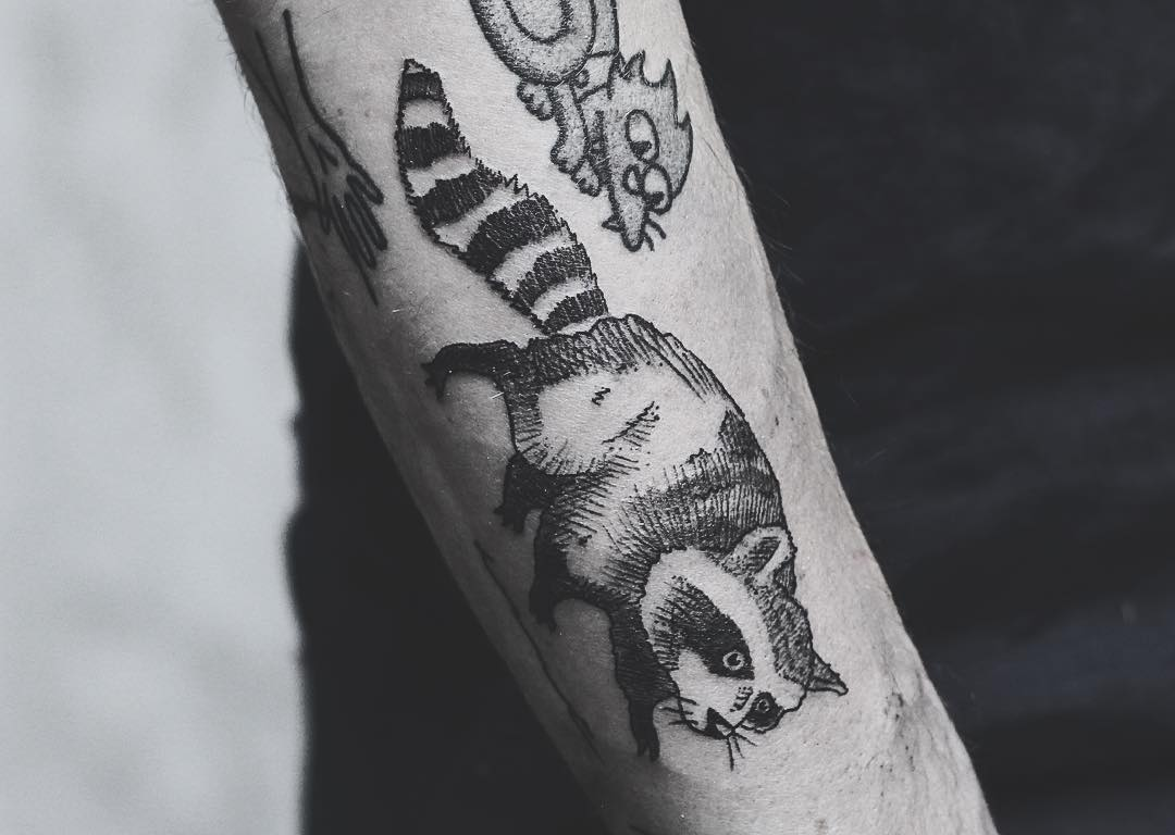 Fun raccoon tattoo by kyle kyo koko