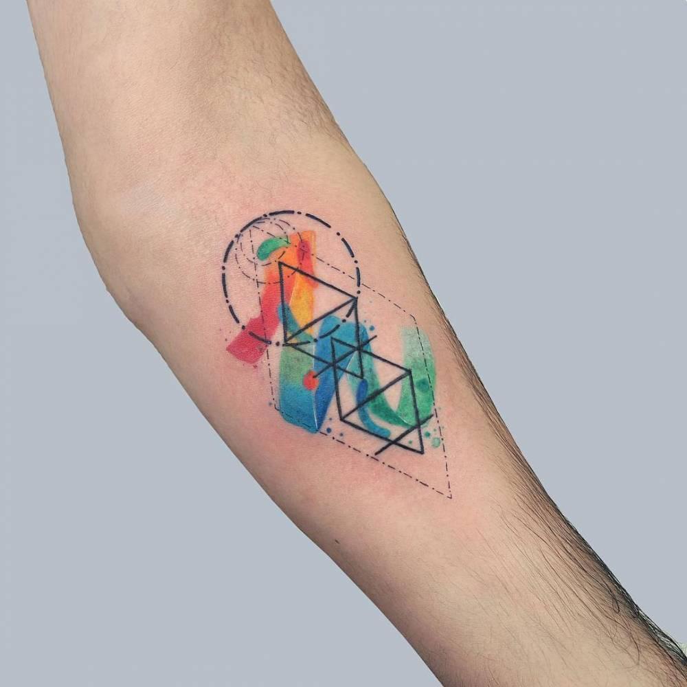 Geometric watercolor tattoo by baris yesilbas