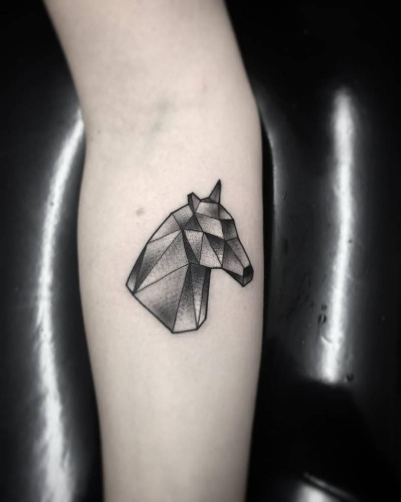 Geometrical horse head tattoo