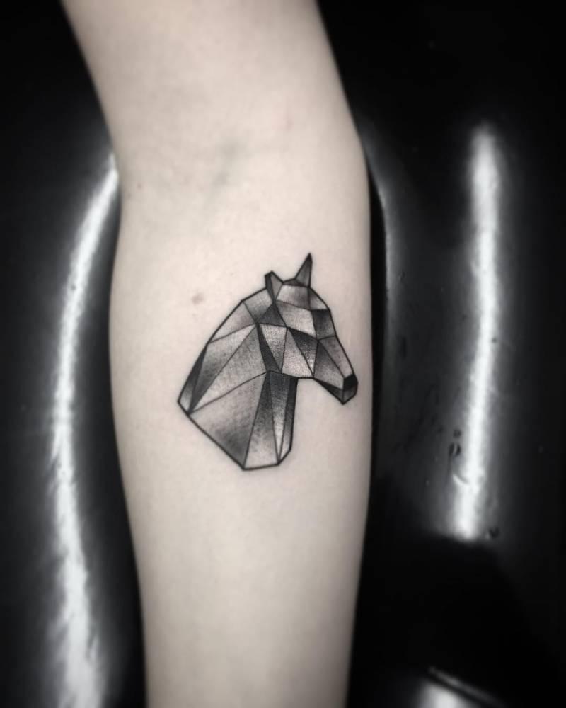 Geometrical horse head tattoo
