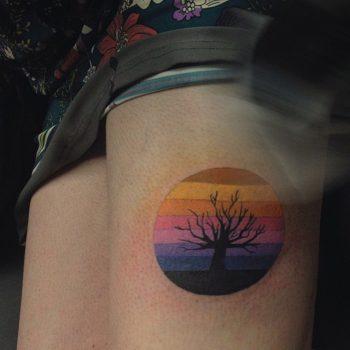 Gradient circle and black tree tattoo