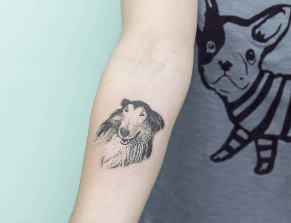 Hand poked collie tattoo