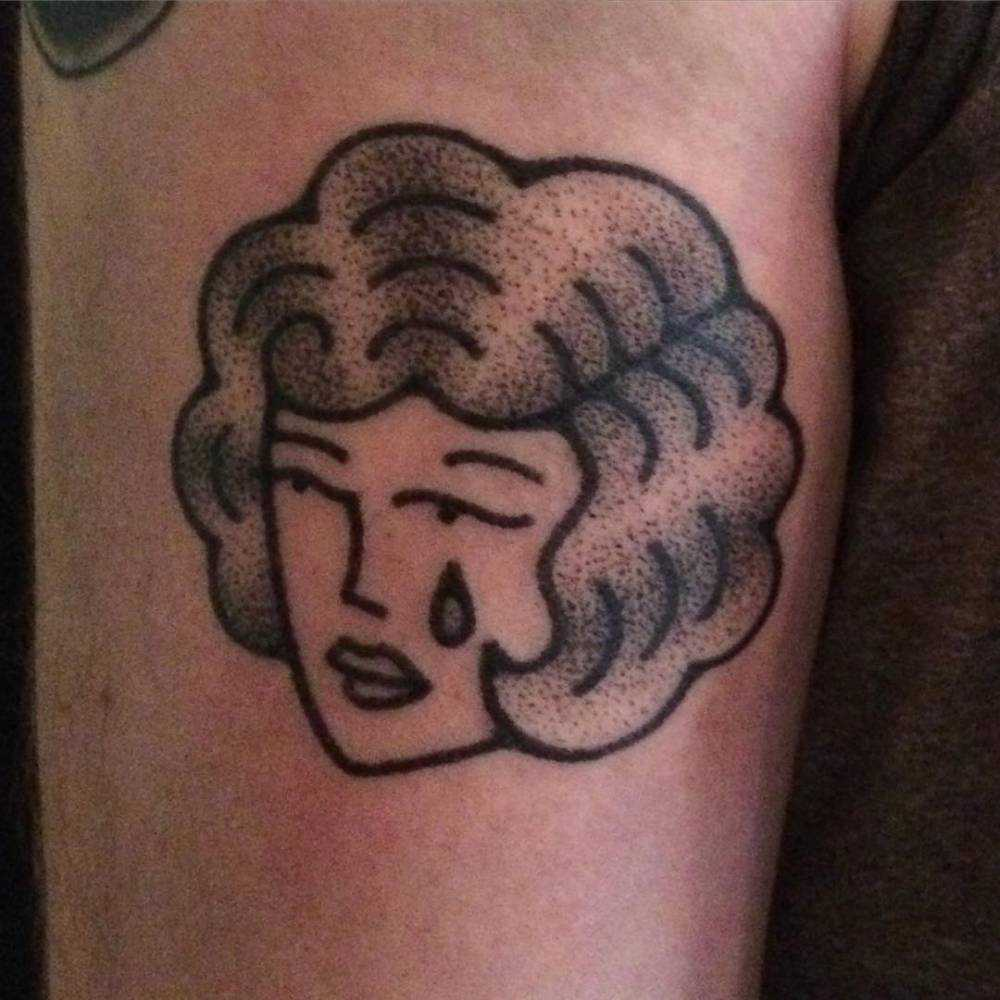 Hand poked crying lady tattoo