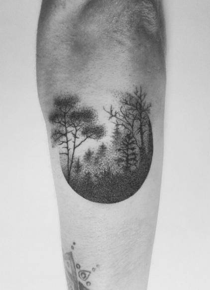 Hand poked foggy forest tattoo