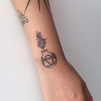 Hand poked plant pot tattoo