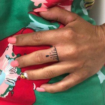 Hand poked ring tattoo