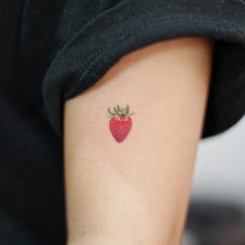 Hand poked strawberry tattoo by tattooist baka