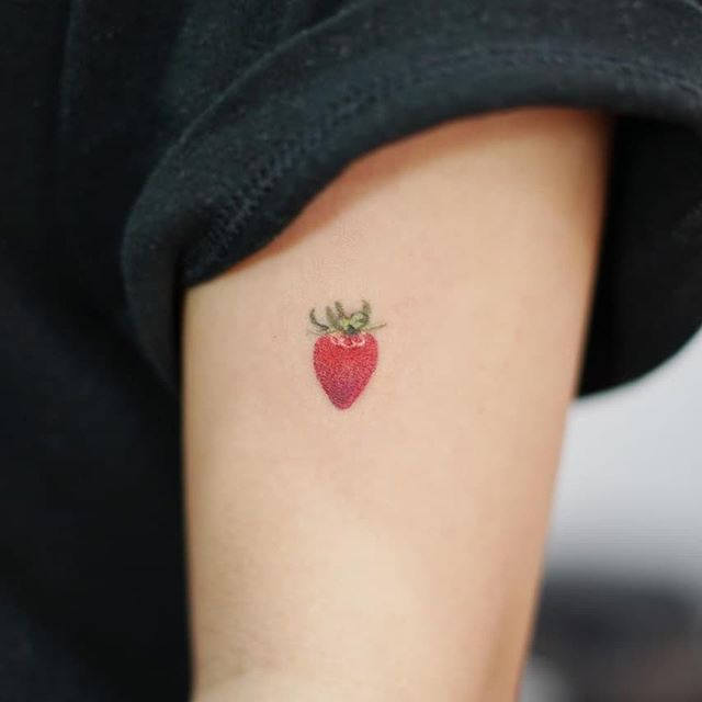Hand poked strawberry tattoo by tattooist baka