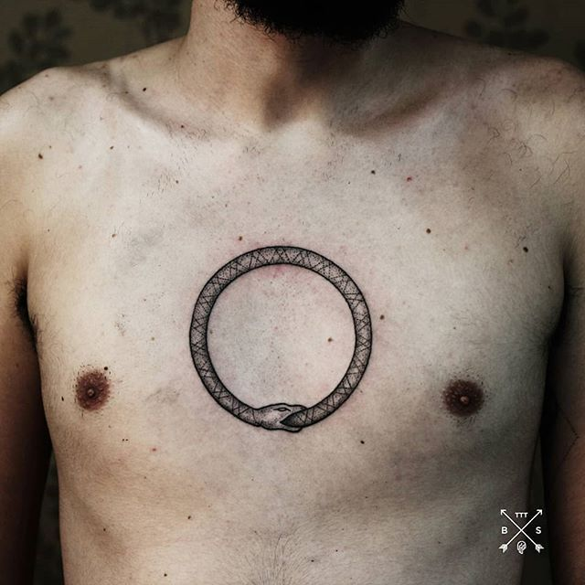 Handpoked ouroboros tattoo on chest