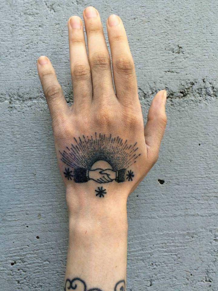 Handshake tattoo by xoïl loïc lavenu