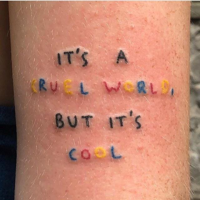 It's a cruel world tattoo