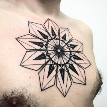 Large geometric mandala tattoo on the chest