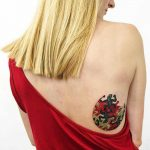 Lizard tattoo on the back