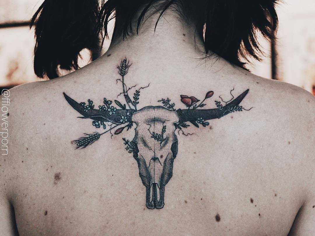Longhorn skull and wildflowers tattoo