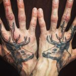 Matching deer tattoos on both hands