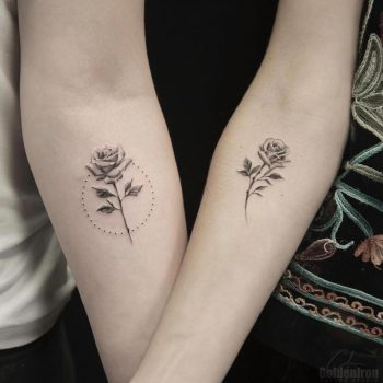 Matching rose tattoos by calvin grxsy