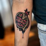 Melting pomegranate tattoo