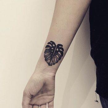 Monstera leaf tattoo hand poked by serena raccuglia