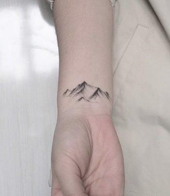 Mountains tattoo by stella tx