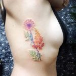 Multicolor flowers tattoo
