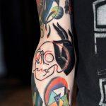 Neon skull and hand tattoo