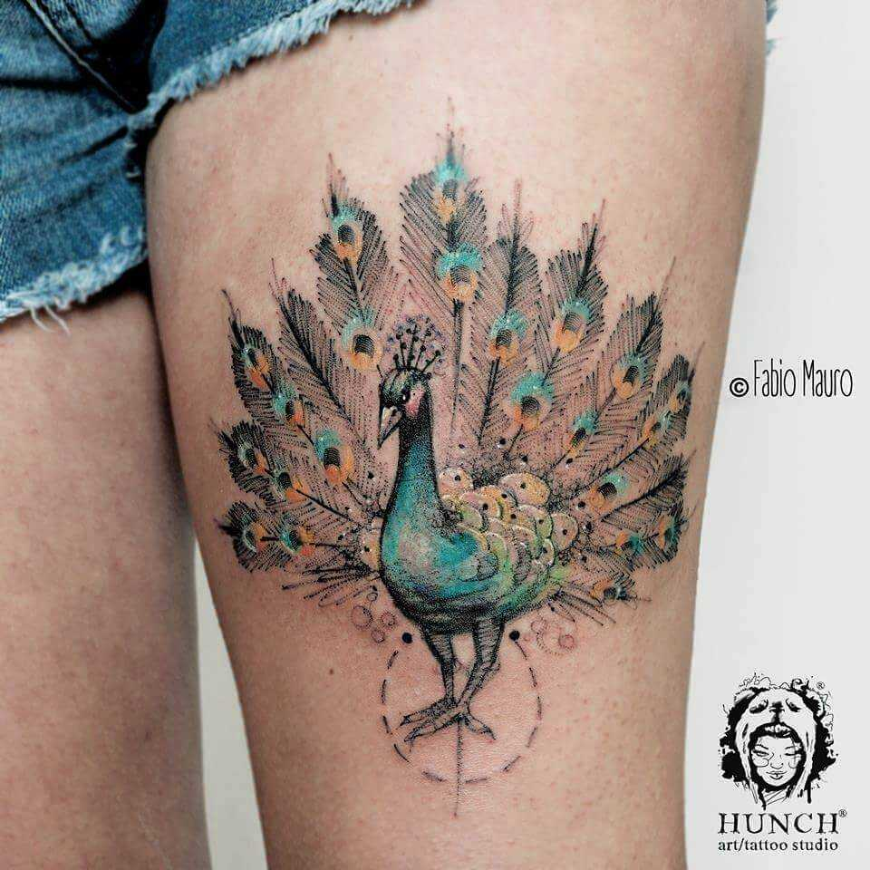 Peacock tattoo on the thigh