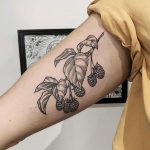 Raspberry branch tattoo