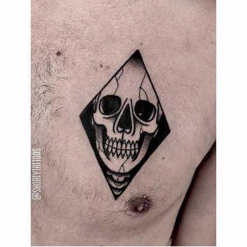 Skull in a rhombus tattoo by ana