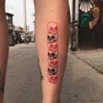 Skull pile tattoo by alex royce