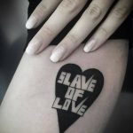 Slave of love tattoo