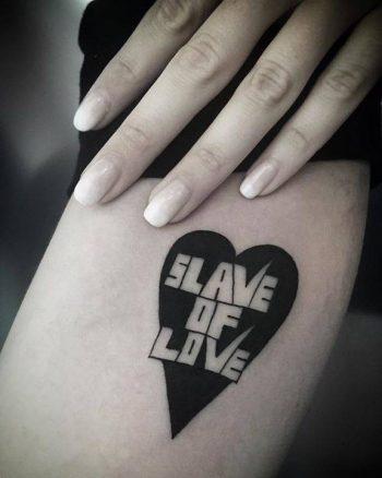 Slave of love tattoo