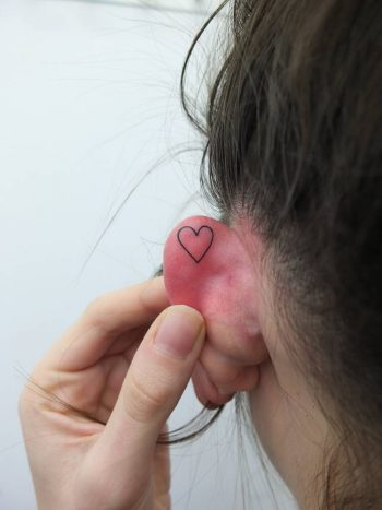 Small heart tattoo by indy voet