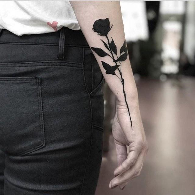 Solid black rose by slumdog tattooer