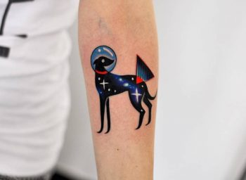 Space greyhound tattoo on the forearm
