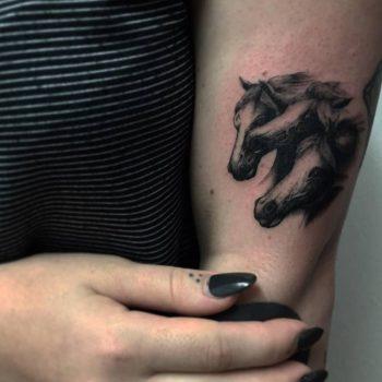 Three horse heads tattoo