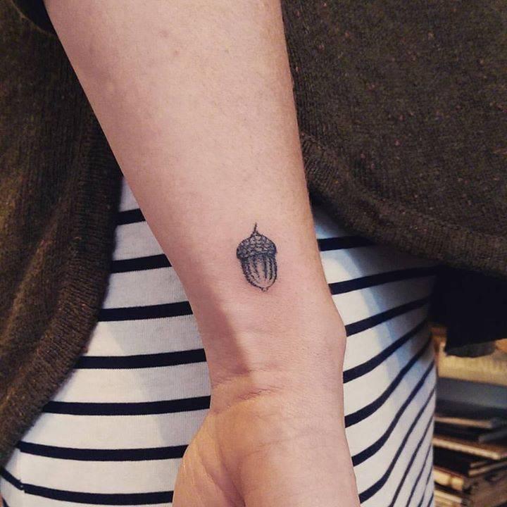 Tiny acorn tattoo on the wrist