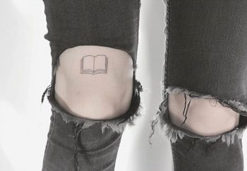 Tiny book tattoo by lindsay april