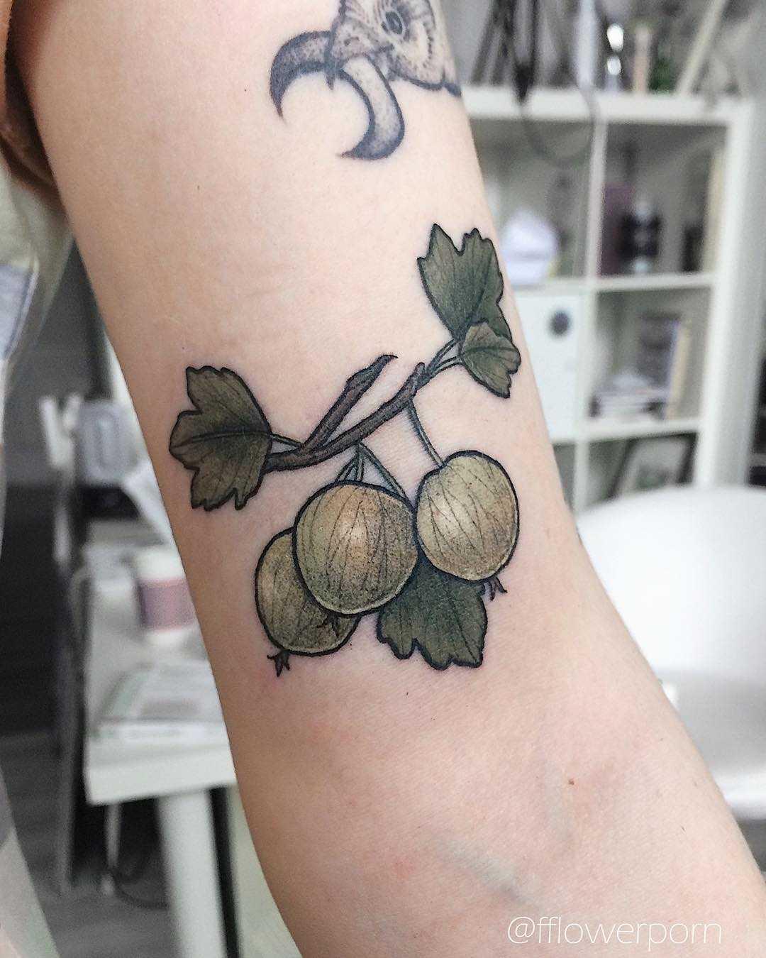 Tiny gooseberry tattoo