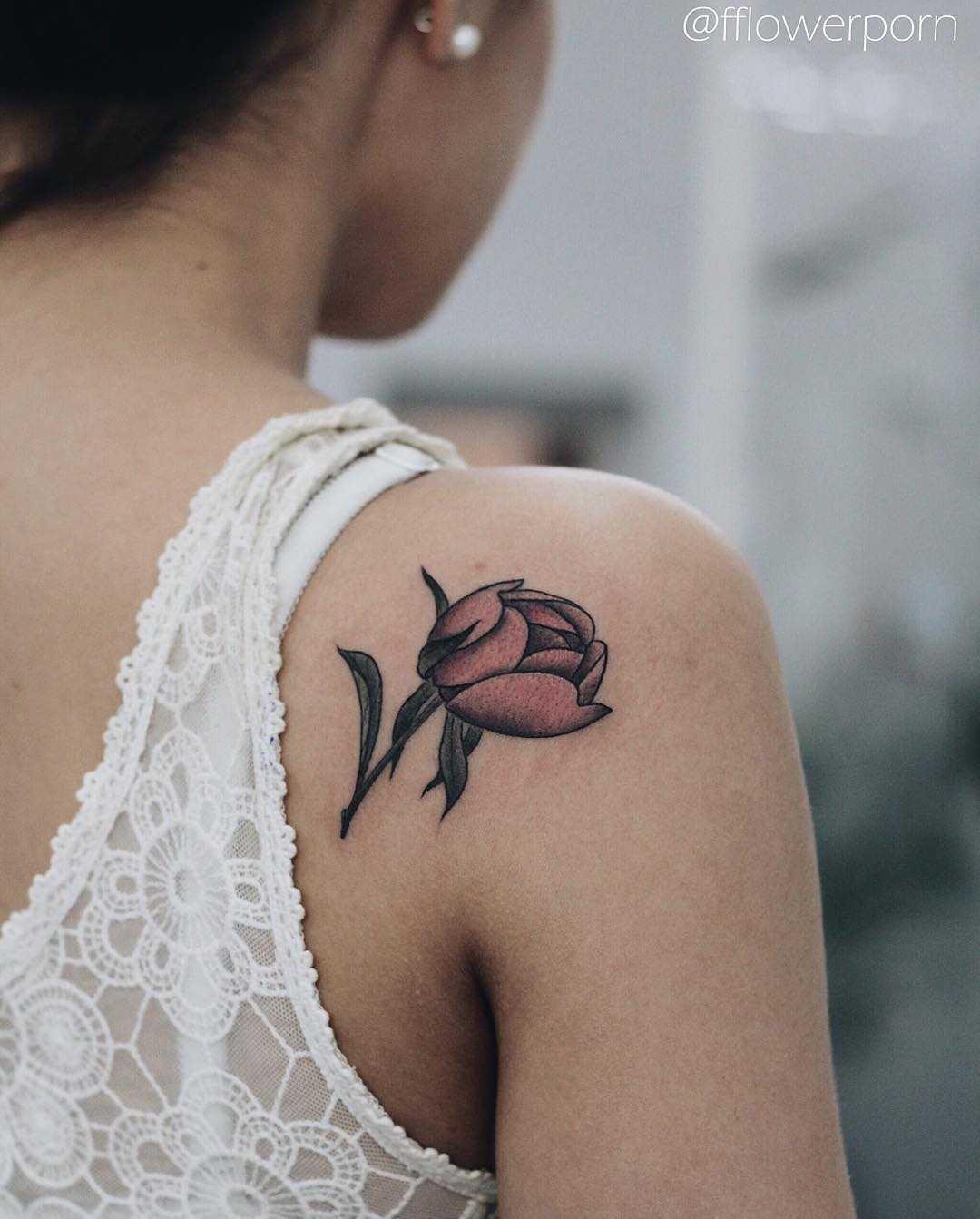 Tiny peony tattoo on the shoulder