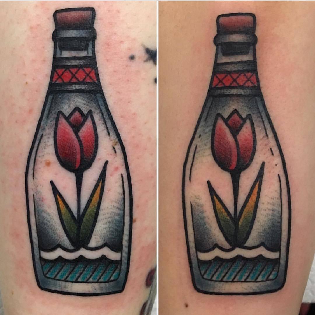 Tulip in a bottle tattoo